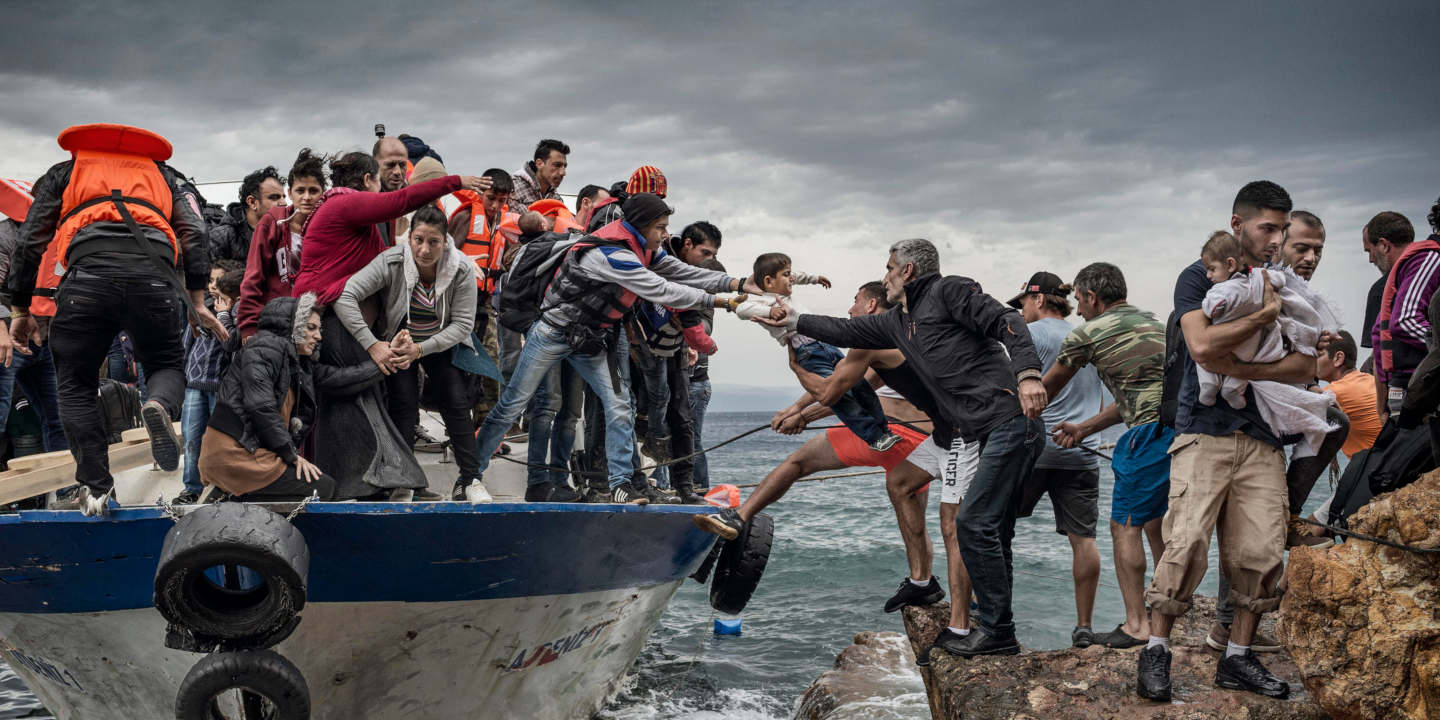 Oct. 11, 2015 - Lesbos Island, Greece - Refugees And Migrants Aboard Fishing Boat Driven By Smugglers Reach The Coast Of The Greek Island Of Lesbos After Crossing The Aegean Sea From Turkey.